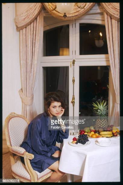 Jane March contemplates the feast of fruit provided in her hotel room. The British actress plays the role of the young girl in French director...