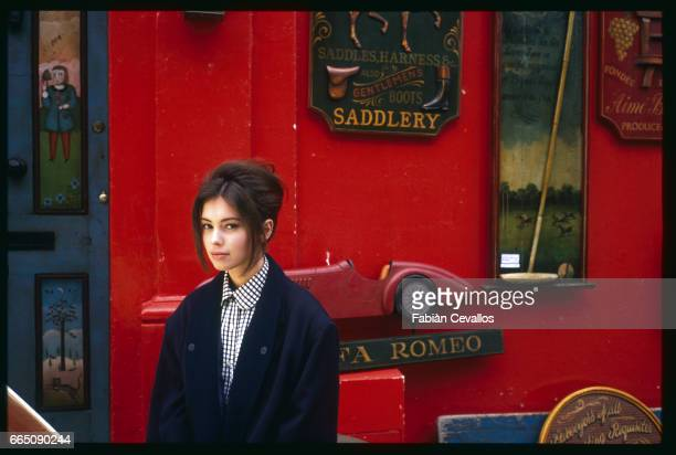 Jane March stands outside a brightly painted English antique shop The British actress plays the role of the young girl in French director JeanJacques...