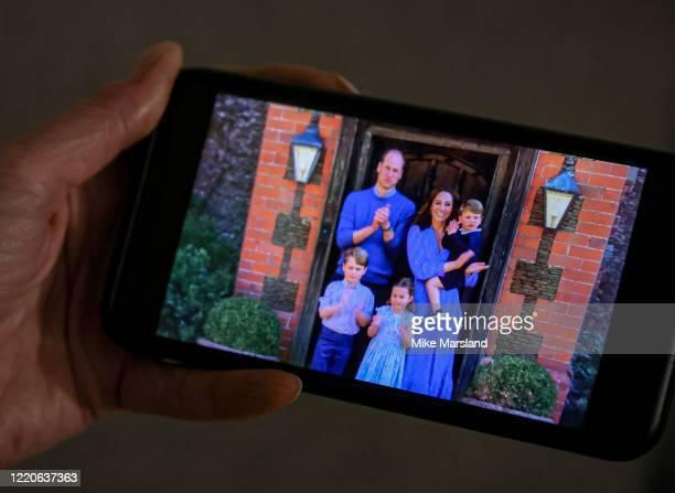 Jane Marsland, wife of the photographer, watches Prince William, Duke of Cambridge, Catherine Duchess of Cambridge, Prince George of Cambridge,...