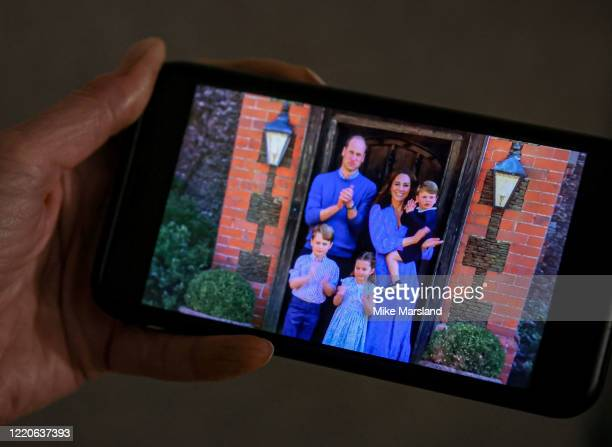 Jane Marsland wife of the photographer watches Prince William Duke of Cambridge Catherine Duchess of Cambridge Prince George of Cambridge Princess...