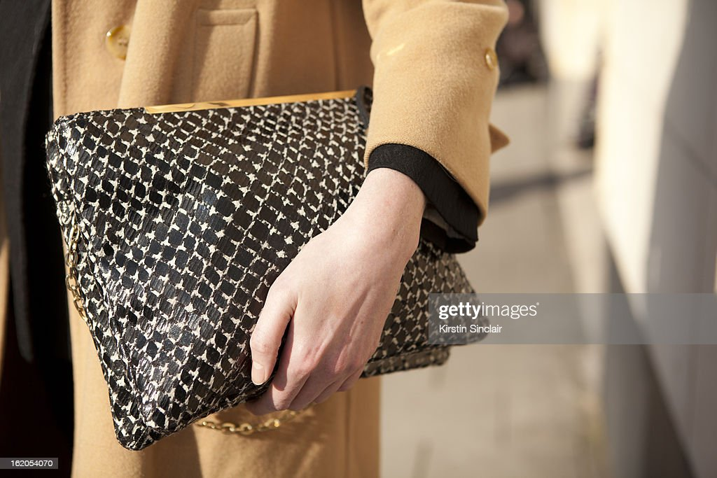 Jane McFarland wears Burberry jacket and Mary Portas clutch on day 3 of London Womens Fashion Week Autumn/Winter 2013 on February 17, 2013 in London, England.