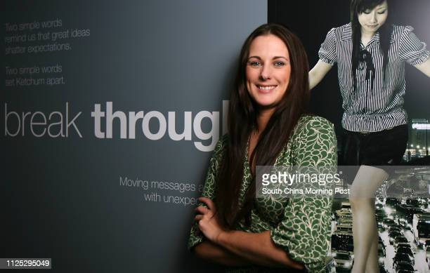 Jane Morgan from Ketchum poses for a photo at the company's office in North Point 23FEB12