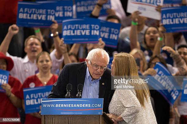 Jane O'Meara Sanders tells her husband Democratic presidential candidate Sen Bernie Sanders that he has won the Oregon primary during a campaign...