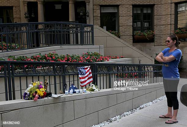 Jane Phillips takes a moment of silence at a makeshift memorial for US Army parachutist Sgt 1st Class Corey Hood near 1400 N Lake Shore Drive in...