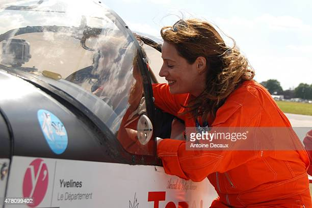 Jane Planchon, the first woman piloting a Canadair firefighter aircraft, congratulates Pilot Dorine Bourneton after she took part in the first...