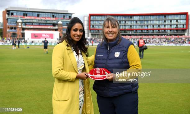 Jane Powell is presented with a cap from her services to coaching by Isa Guha during day four of the 4th Specsavers Ashes Test match between England...