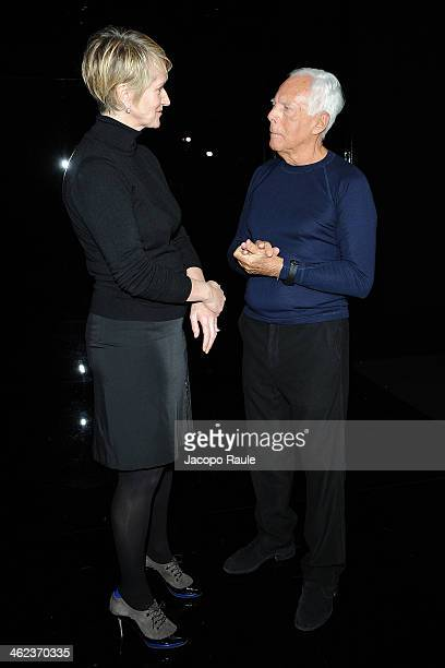 Jane Reeve and Giorgio Armani attend the Emporio Armani show as a part of Milan Fashion Week Menswear Autumn/Winter 2014 on January 13 2014 in Milan...