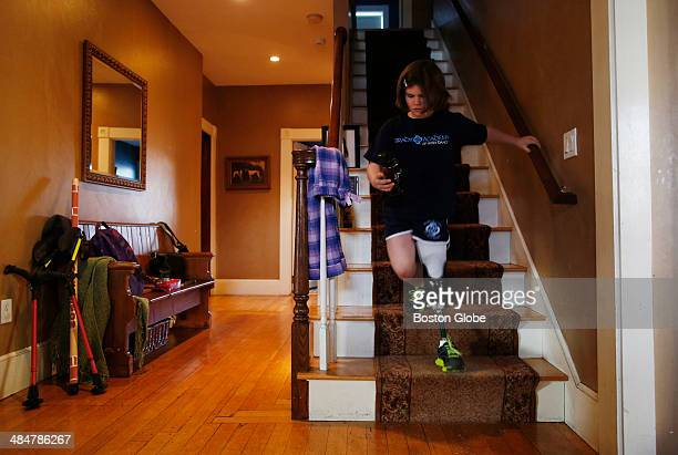 Jane Richard runs down the stairs at home as she gets ready to leave for an appointment at Spaulding on February 10 2014 Back at school her teachers...