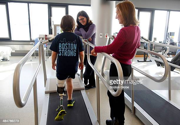 Jane Richard uses a treadmill as she laughs with her mother Denise Richard center and physical rherapist Jean Murby during a check up at Spaulding in...