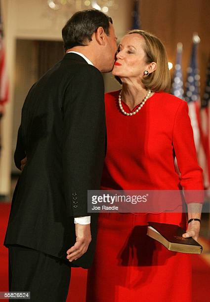 Jane Roberts kisses her husband, John Roberts, after his swearing in ceremony as Chief Justice of the U.S. By Associate Justice John Paul Stevens in...