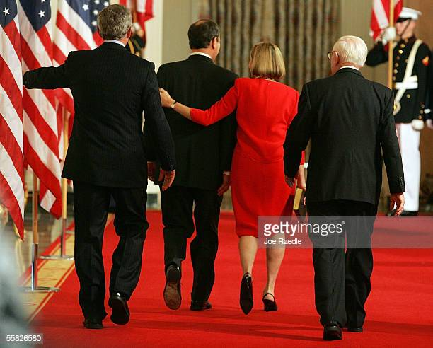 Jane Roberts walks with her arm around her husband John Roberts as they are followed by US President George W Bush and Associate Justice John Paul...