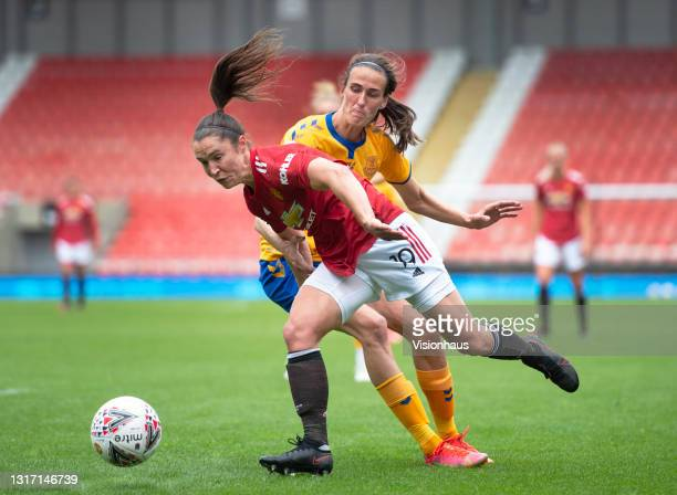 Jane Ross of Manchester United and Jill Scott of Everton in action during the Barclays FA Women's Super League match between Manchester United Women...