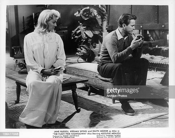 a51a7ad286 Jane Russell sits with Ralph Meeker in a scene from the film  The Fuzzy Pink