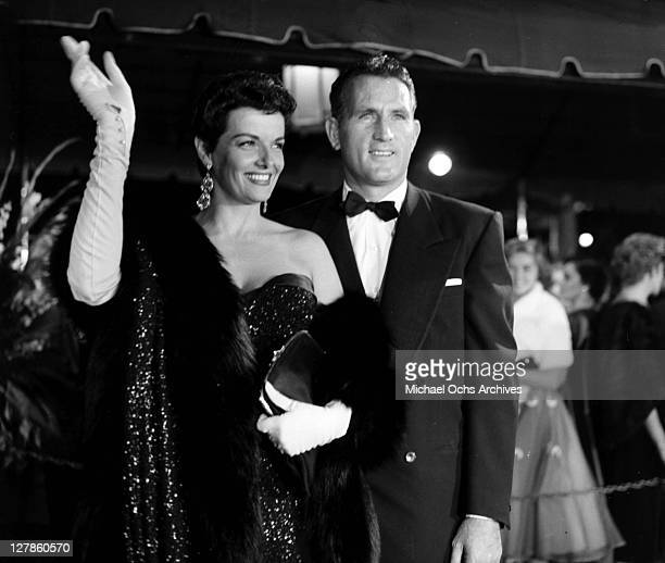 Jane Russell with her husband Bob Waterfield in red carpet appearance circa 1955