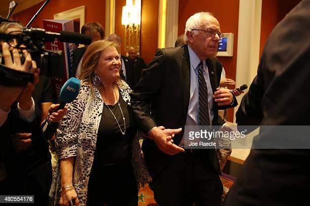 Jane Sanders and her husband Democratic presidential candidate US Sen Bernie Sanders leave the spin rooom after Bernie Sanders took part in a...