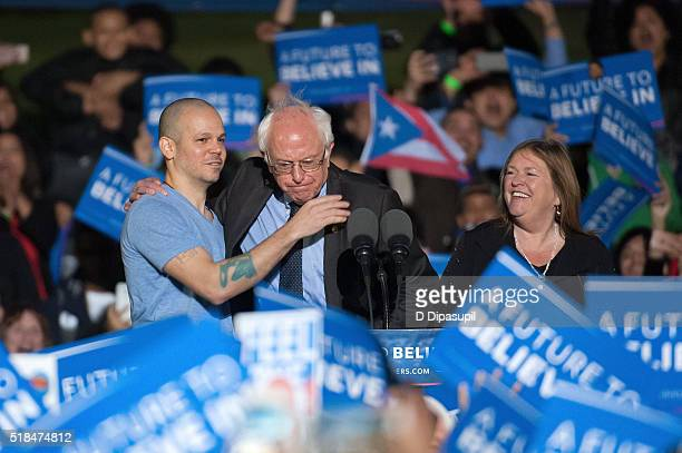 Jane Sanders looks on as Residente of Calle 13 greets 2016 Democratic presidential candidate US Senator Bernie Sanders onstage at a campaign event at...