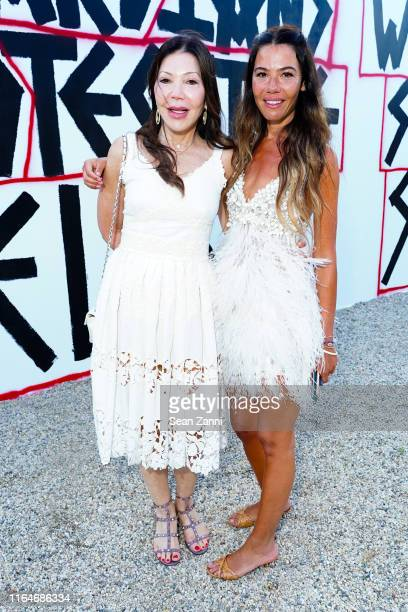 Jane Scher and Libbie Mugrabi attend Tabula Rasa The 26th annual Watermill Center Benefit Auction at The Watermill Center on July 27 2019 in Water...