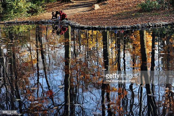 Jane Schlesinger, 10 years old and Starr Rhee touch the pond that was part of the restoration. The restored Tregaron estate served as an outdoor...