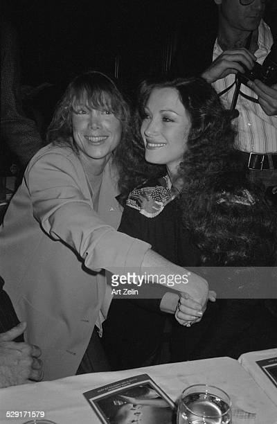 Jane Seymour and Sissy Spacek holding hands at a dinner circa 1970 New York
