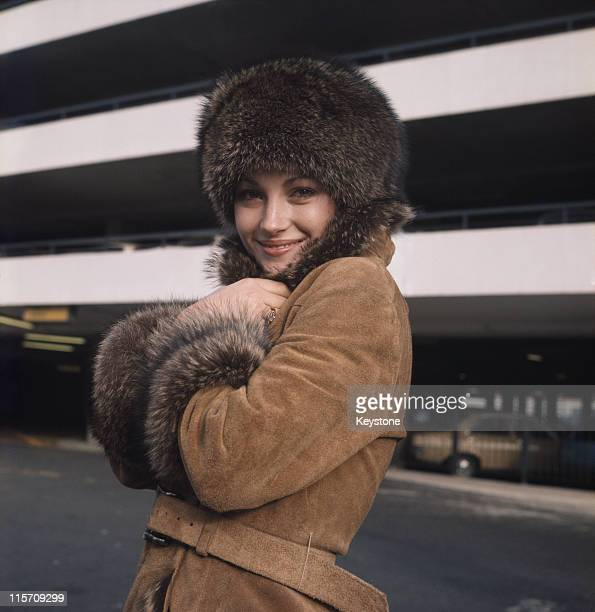 Jane Seymour British actress poses wearing a suede coat with a fur collar and a fur hat 1972