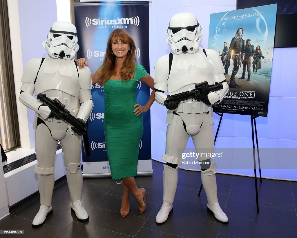 Jane Seymour (C) pose with Stormtroopers for Blu-Ray release of Rouge One at SiriusXM Studios on April 4, 2017 in New York City.