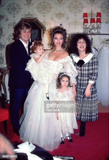 Jane Seymour the English actress who at the time was starring in Dr Quinn Medicine Woman poses with her children and David and Elizabeth Emanuel in a...