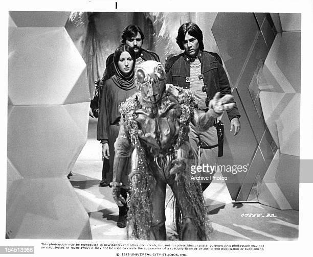 Jane Seymour, Tony Swartz and Richard Hatch follow an alien in a scene from the television series 'Battlestar Galactica', 1978.
