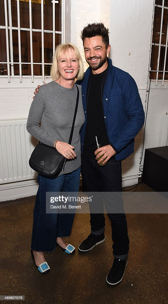 Jane Shepherdson (L) and Dominic Cooper attend Whistles Men 1st birthday celebrations at Protein Galleries on October 22, 2015 in London, England.