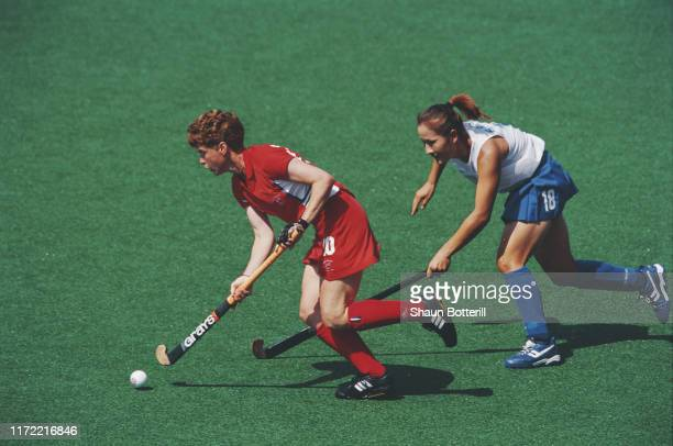 Jane Sixsmith of Great Britain holds off Cho BoRa of Korea during their Pool A match of the Women's Field Hockey tournament on 20th September 2000...
