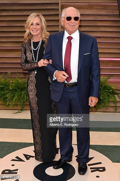 Jane Slagsvol and msuician Jimmy Buffet attend the 2014 Vanity Fair Oscar Party hosted by Graydon Carter on March 2 2014 in West Hollywood California