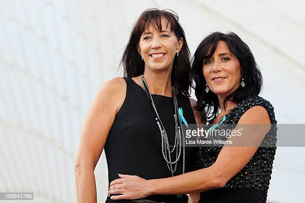Jane Stephens and Trish Bailey pose on the Opera House steps just after its sails were illuminated for Teal Ribbon Day in honor of women who have...