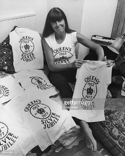 Jane Stonehouse displays one of the tshirts which she designed for Queen Elizabeth II's silver jubilee The tshirts feature a crown motif surrounded...