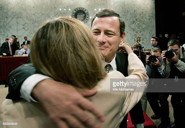 Jane Sullivan Roberts wife of Supreme Court Chief Justice Nominee John Roberts reaches to kiss her husband at the end of the judge's testimony during...