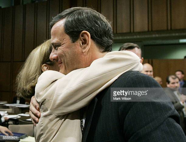 Jane Sullivan Roberts wife of Supreme Court Chief Justice Nominee John Roberts embraces her husband at the end of the judge's testimony during...