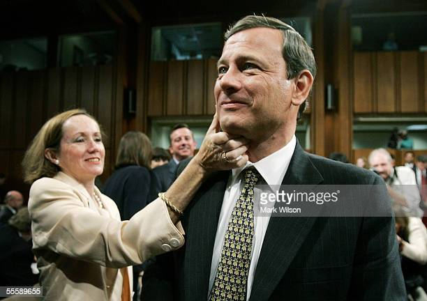 Jane Sullivan Roberts wife of Supreme Court Chief Justice Nominee John Roberts wipes lipstick from Roberts' cheek after giving him a kiss at the end...