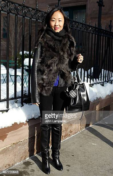 Jane Sung from Lucky Magazine is seen wearing a vest from Korea, Hugo Boss boots, APC bag, and jeans from Seven during New York Fashion Week Fall...