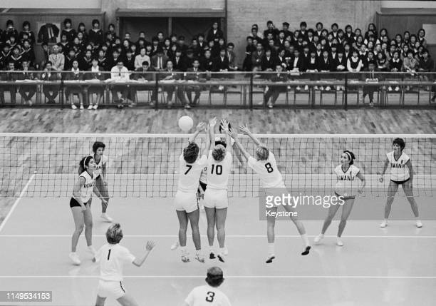 Jane Ward, Mary Peppler and Mary Perry of the United States attempt to block the ball against the attack of Rumania during their Women's Olympic...