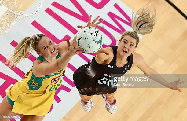 Jane Watson of the Silver Ferns and Caitlin Bassett of the Diamonds compete for the ball during the International Test match between the Australian...