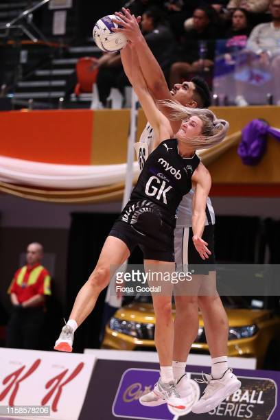 Jane Watson of the Silver Ferns goes for an intercept against Junior Levi of the NZ Men during the Cadbury Netball Series match between the Silver...