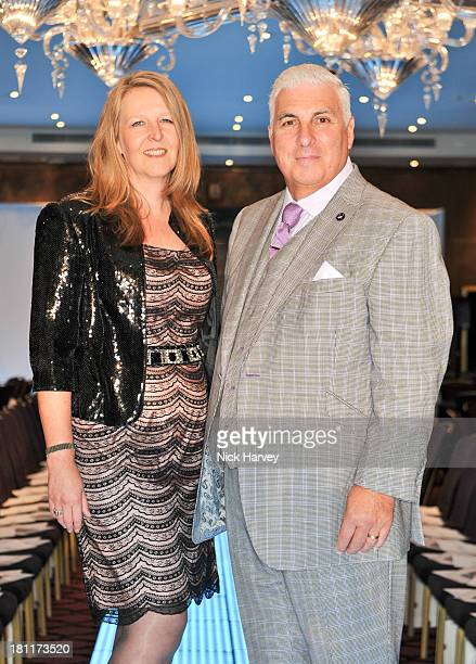 Jane Winehouse and Mitch Winehouse attend the Nina Naustdal Runway show following London Fashion Fashion Week SS14 at The Mayfair Hotel on September...