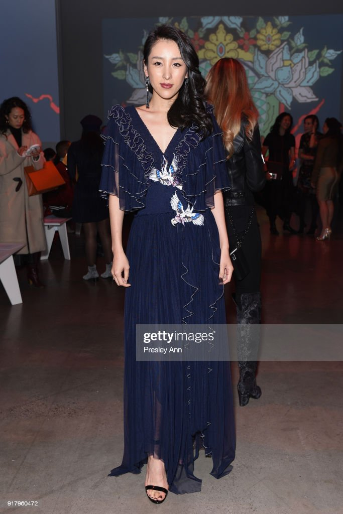 Jane Wu poses backstage for Vivienne Tam during New York Fashion Week at Spring Studios on February 15, 2018 in New York City.