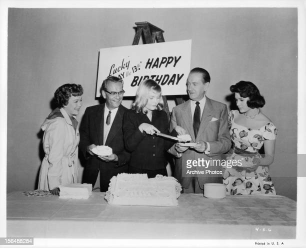 Jane Wyman Carol Lynley Clifton Webb and Jill St John celebrate a birthday in between takes of the film 'Holiday For Lovers' 1959