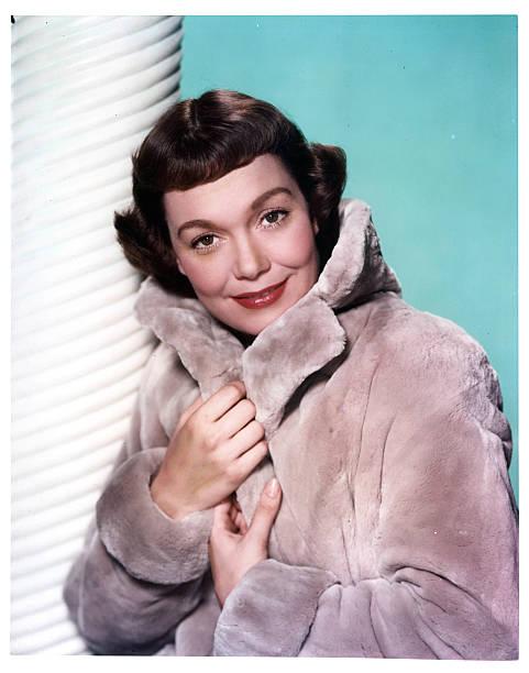 jane-wyman-wears-a-fur-coat-in-a-scene-f