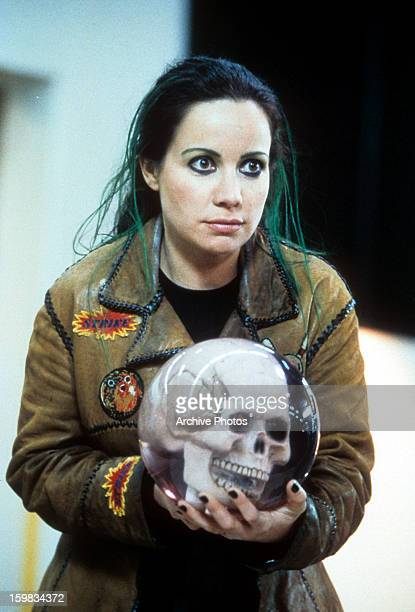 Janeane Garofalo holds an orb in a scene from the film 'Mystery Men' 1999