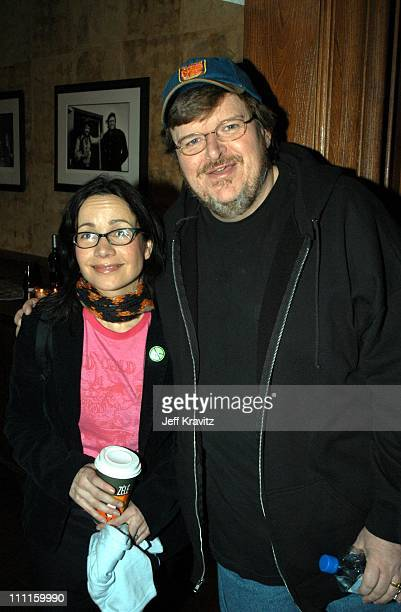 Janeane Garofalo Michael Moore during Hollywood Reporter Honors Michael Moore at Whiskey Rocks at the St Regis in Aspen Colorado United States