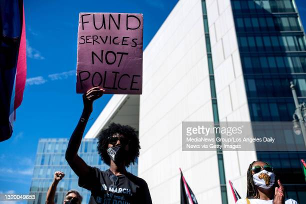 Janee Lennox, of Culver City, joins a Black Lives Matter rally outside LAPD Headquarters in Los Angeles during the first anniversary of George...