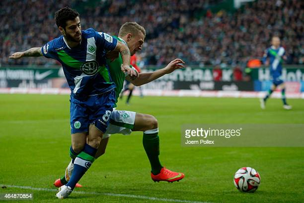 Janek Sternberg of Bremen and Vieirinha of Wolfsburg compete for the ball during the Bundesliga match between SV Werder Bremen and VfL Wolfsburg at...
