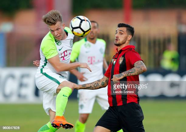 Janek Sternberg of Ferencvarosi TC competes for the ball with Davide Lanzafame of Budapest Honved during the Hungarian OTP Bank Liga match between...