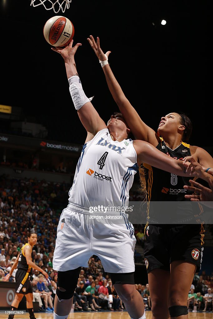 Janel McCarville #4 of the Minnesota Lynx and Elizabeth Cambage #8 of the Tulsa Shock fight for the rebound during the WNBA game on August 16, 2013 at Target Center in Minneapolis, Minnesota.