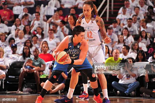 Janel McCarville of the Minnesota Lynx posts up against Brittney Griner of the Phoenix Mercury in Game 1 of the 2014 WNBA Western Conference Finals...